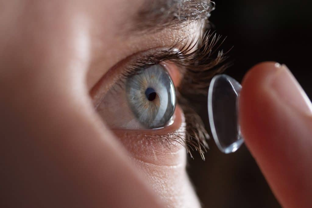 Close-up of a man putting contact lenses