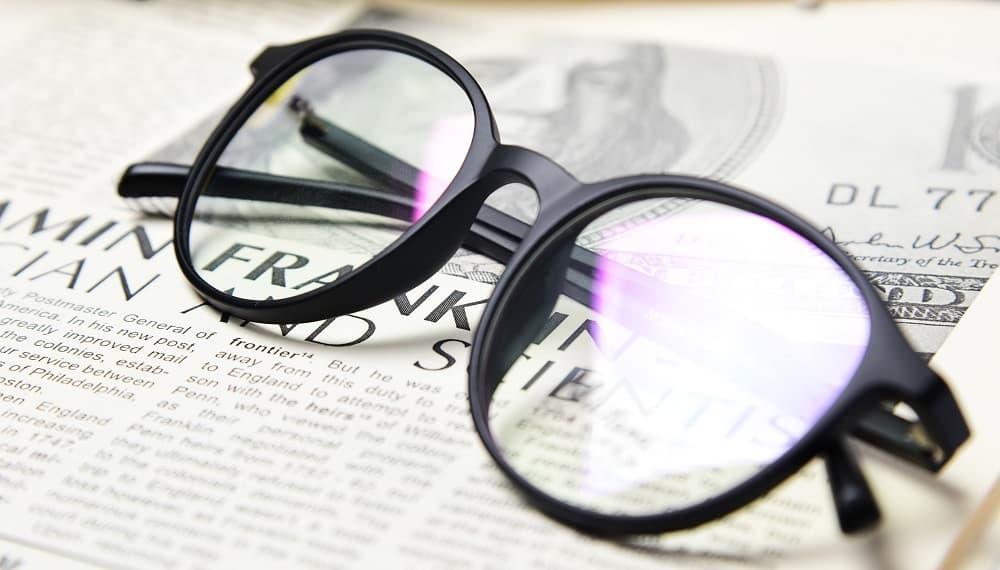 Glasses on newspapper